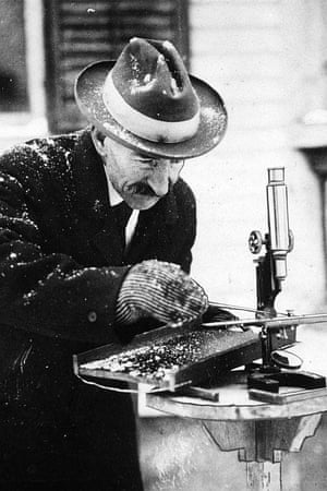 """This undated photo shows Wilson Bentley working on photographing a snowflake. Bentley would spend nearly four decades capturing thousands of intricate images on glass plates, earning the nickname """"Snowflake Man"""" among his neighbors, who thought it all a bit odd"""