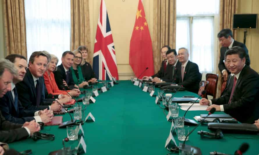 Xi Jinping meets David Cameron and other senior members of his government in the cabinet room at 10 Downing Street.