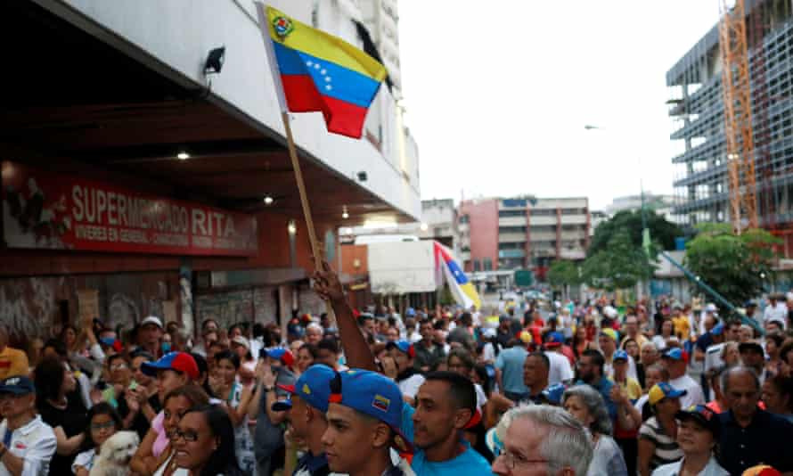 Opposition supporters wait near a polling station for results of an unofficial vote against President Nicolas Maduro's government in Caracas, Venezuela, on Sunday.