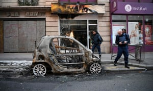 A burned out car in Paris on Sunday