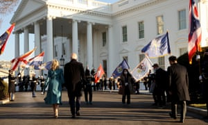 Flags wave as Biden and his wife Jill arrive at the White House.