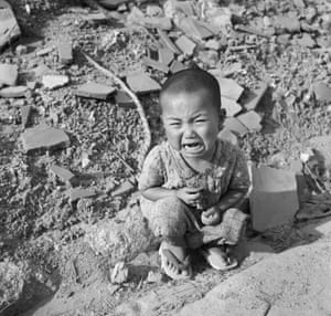 A toddler cries amid the rubble of Hiroshima