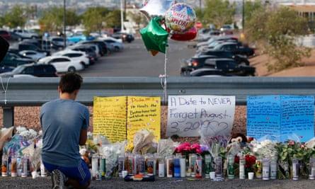 A young man prays at a makeshift memorial in El Paso, Texas.