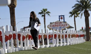 Sherri Camperchioli helps set up some of the crosses that arrived in Las Vegas today to honor the victims of the mass shooting on Thursday, Oct. 5, 2017, in Las Vegas. A gunman opened fire on an outdoor music concert on Sunday killing dozens and injuring hundreds. (AP Photo/Gregory Bull)