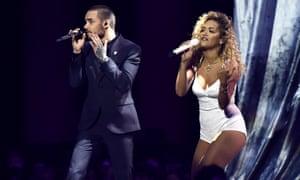 Rita Ora and Liam Payne perform.