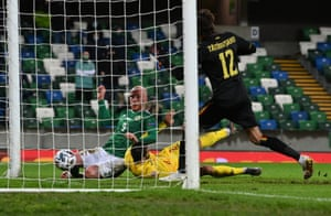 Liam Boyce of Northern Ireland scores their team's first goal.