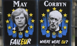 Posters mocking May and Corbyn outside parliament.