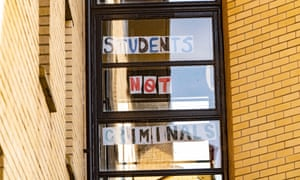 Students self-isolating inside their halls of residence in Glasgow post messages on the windows.