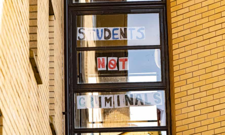 Students self-isolating inside their halls of residence in Glasgow have put messages in their windows.