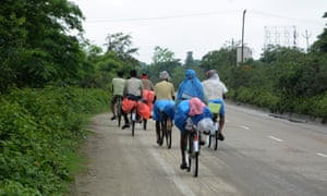 Migrant workers on bicycles, on their way to their native places in Bihar from Golaghat district during the ongoing coronavirus lockdown, at Nalbari district of Assam, India, 24 May 2020.