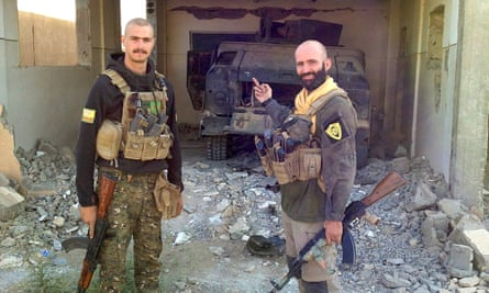 Oliver Hall pictured with a fellow YPG fighter
