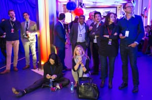 Guests watch the results come in at a US election night party at the US embassy in London