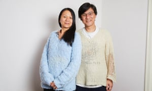 Kim Wong and his wife, Moi, wearing jumpers his mother knitted in the 1980s.