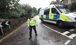 Police officer blocks the road leading to Toddbrook Reservoir