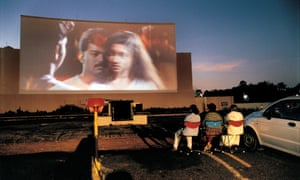People watch a film at drive-in cinema in Chennai, southern India