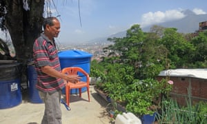 Camacho shows off his rooftop vegetable and herb garden in Caracas.