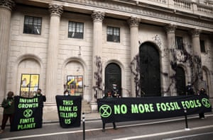 Extinction Rebellion activists protest outside the Bank of EnglandActivists from the Extinction Rebellion, a global environmental movement, protest outside the Bank of England, in London, Britain, April 1, 2021. REUTERS/Henry Nicholls