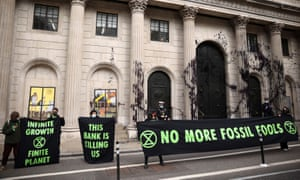 Activists from the Extinction Rebellion protesting outside the Bank of England, in London, today
