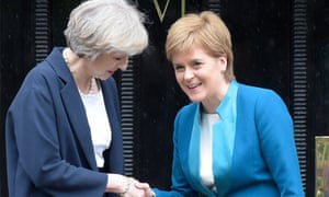 Theresa May is greeted by Nicola Sturgeon ahead of talks in Edinburgh in July 2016.