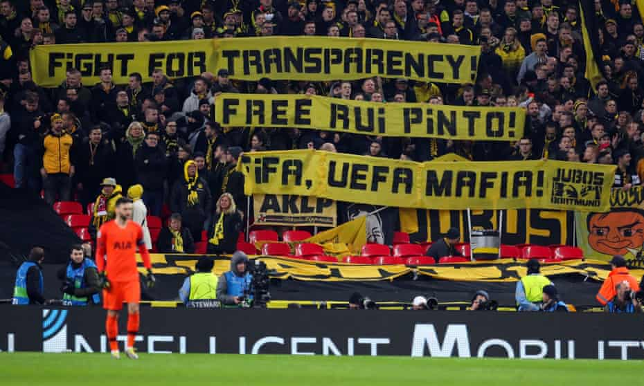 Borussia Dortmund fans hold up a message in support of Rui Pinto during the Champions League round of 16 first leg match against Tottenham Hotspur at Wembley Stadium in February 2019.