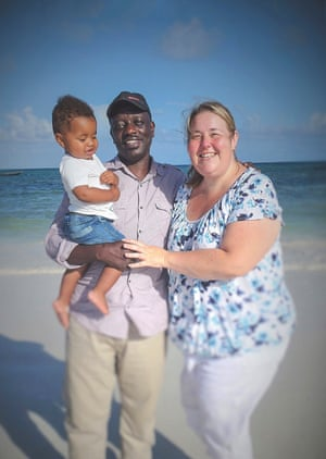 Mandy Williams and George Okoth and their son, Eric, in Kenya, in October 2017 – it was the first time Okoth had met his son