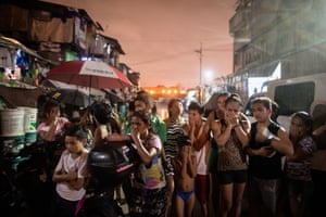 Residents react near a crime scene where three alleged drug dealers were killed after a drug raid in a shanty community in Manila.
