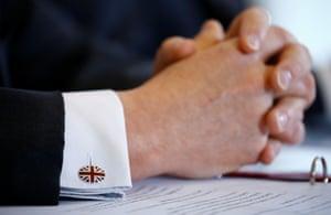 Britain's secretary of state for international trade, Liam Fox, wearing union-flag cufflinks in Bern, Switzerland