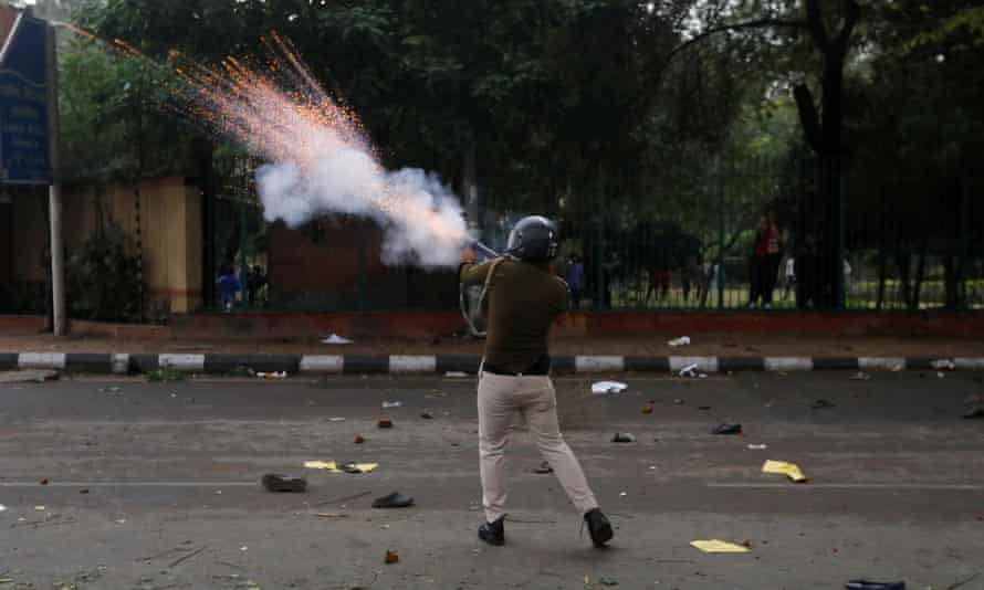 A police officer fires a teargas shell during the protest.