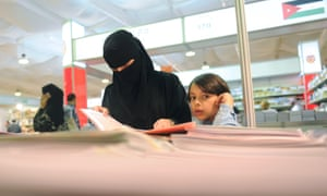 A Saudi woman attends the International Book Fair in the Red Sea city of Jeddah.