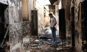 A Médecins Sans Frontières worker walks inside the remains of a hospital destroyed by a US airstrike in Kunduz in 2015.