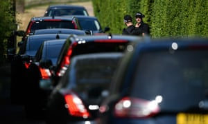Armed police officers check a queue of ministerial cars as they arrive at the prime minister's country retreat, Chequers, for today's Brexit cabinet meeting.
