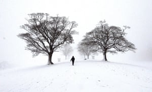 A walker in the snow at Lyme Park, near Stockport, Cheshire