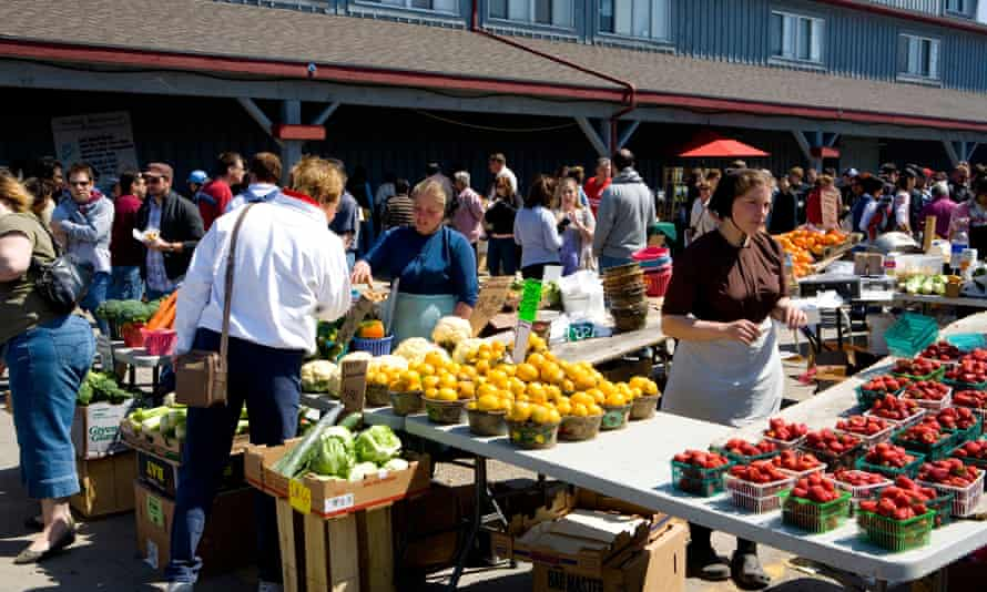 Mennonites at a market in St Jacobs Ontario, Canada. The province has lost 20% of its farmland in the past 40 years.