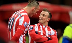 Stoke City's Xherdan Shaqiri, right, celebrates after scoring his team's winning goal at the Britannia Stadium.