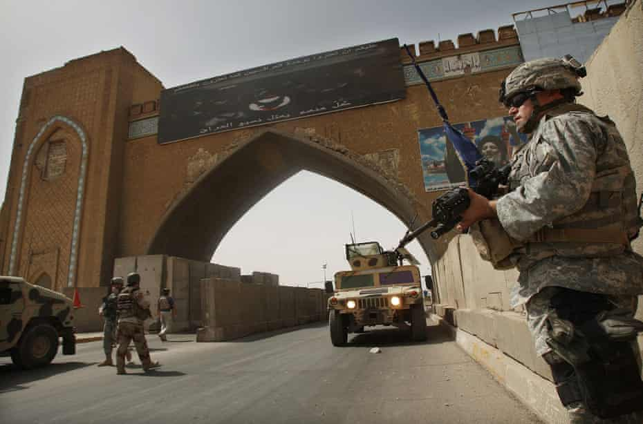 City watch … US army troops stand guard at a checkpoint in Baghdad, Iraq, in August 2007.