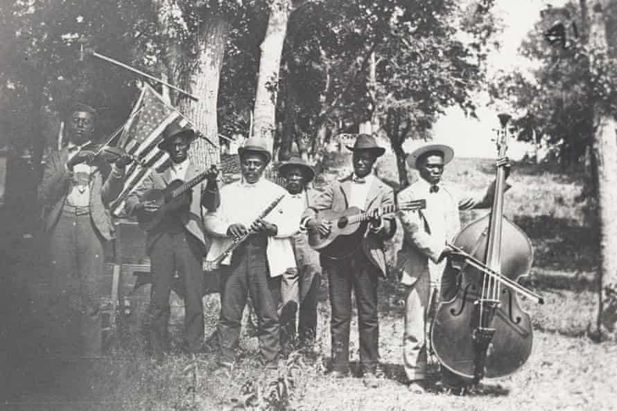 Musicians play at a Juneteenth celebration in Texas in 1900.