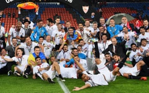 The Sevilla players celebrate with the trophy.