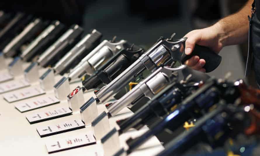 Handguns are displayed at the Smith & Wesson booth at the Shooting, Hunting and Outdoor Trade Show in Las Vegas.