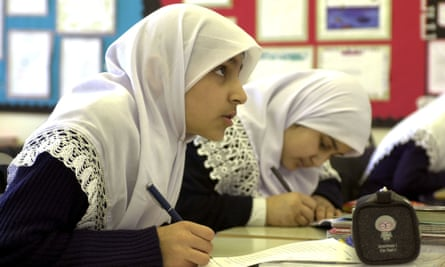 Muslim schoolgirls in class