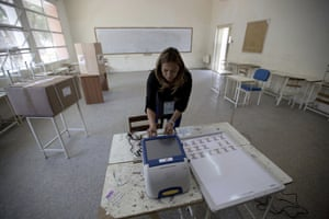 An employee of Venezuelan electoral council sets up a voting machine at a polling station in Caracas.