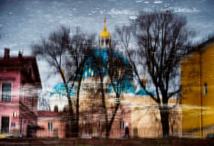 The Trinity Cathedral is reflected in the Fontanka River in Saint Petersburg.