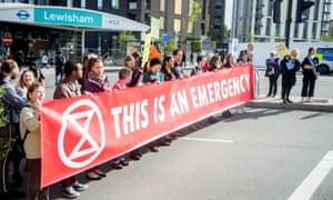 Extinction Rebellion campaigners block a road in Lewisham.