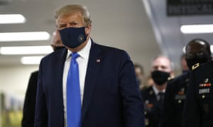 Donald Trump wears a face mask during a visit to Walter Reed National Military Medical Center
