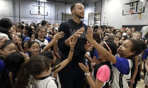 Stephen Curry greets players at an all-girls basketball camp in Walnut Creek, California