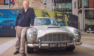 Andy Palmer, the CEO of Aston Martin, posing with a 1963 Aston Martin DB5 outside the London Stock Exchange.