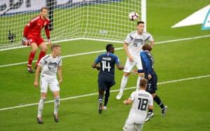 France's Antoine Griezmann glances his header into the far corner of Neuer's goal.