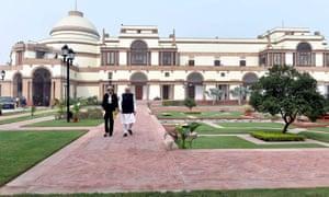 Narendra Modi walks with Theresa May at Hyderabad House in Delhi.