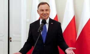 The Polish president, Andrzej Duda, speaks to the media after initial poll results indicated he had been re-elected in a run-off vote