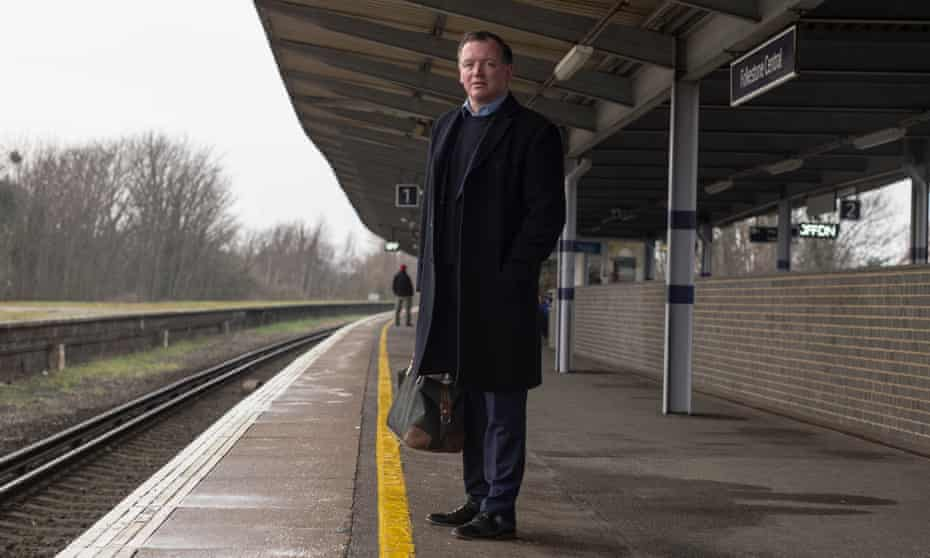 Damian Collins waits for a train back to London from his constituency.