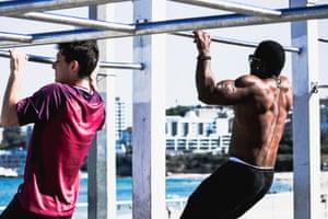 Men do chin-ups at the famous outdoor beachside gym at North Bondi